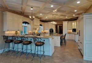 Elegant kitchen with grand ceiling and amazing cabinetry