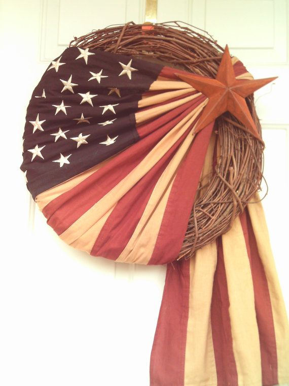 Primitive Patriotic  Stained Flag Wreath by imaproudcrafter. Would be neat to use an old rope.