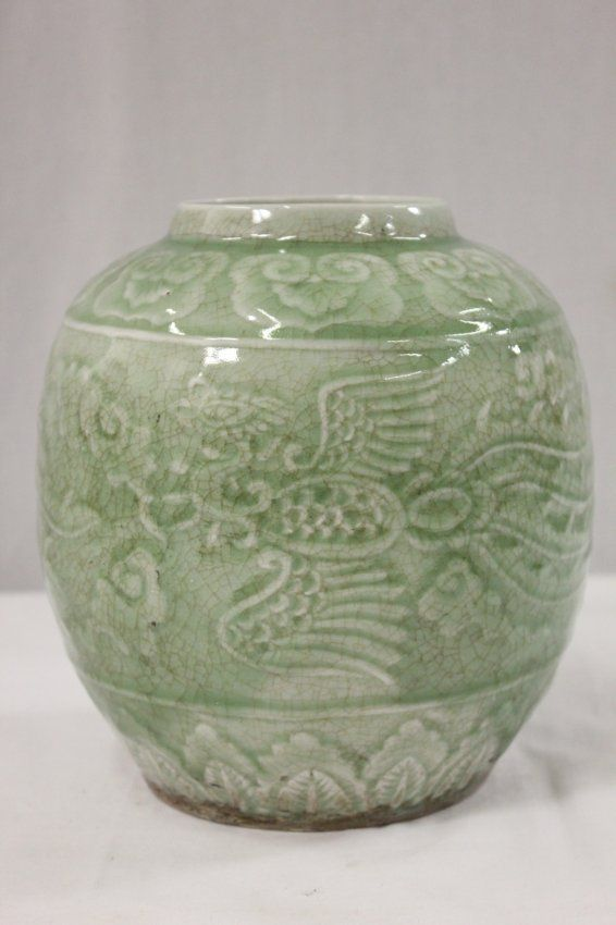 """A fine Chinese vintage celadon porcelain jar (8""""H x 7.25""""dia) decorated with phoenix in relief, with crackle throughout"""