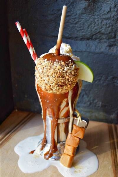 Candy Apple Milkshake: A vanilla milkshake that's rimmed with caramel sauce, topped with a caramel-dipped apple with nuts, whipped cream and an apple slice, then served with caramel chews