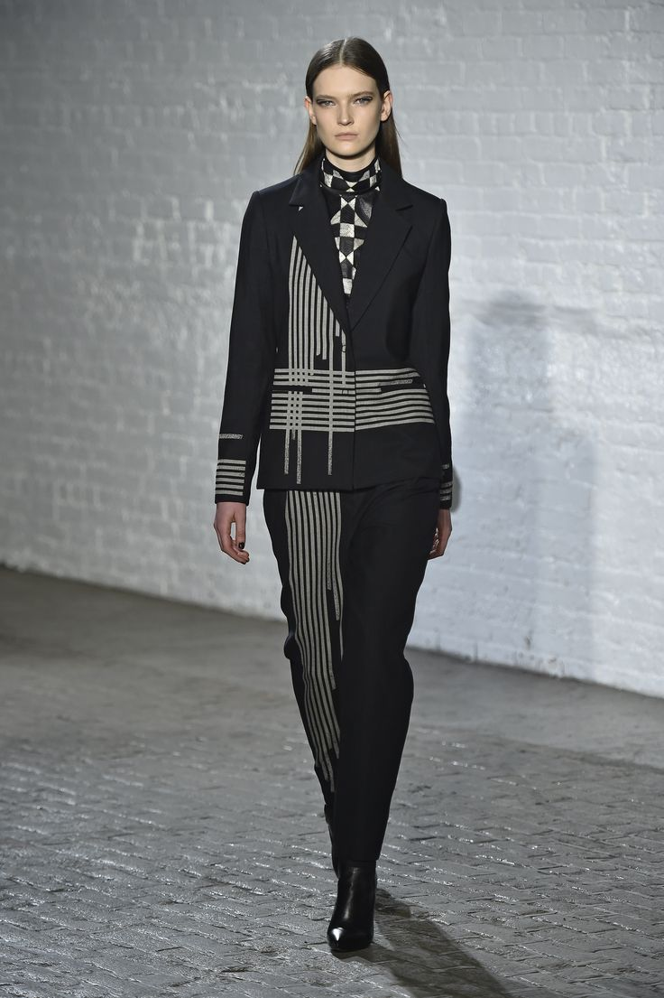 The Intersected Linear Wool Jacquard Jacket, The Python Patchwork Sleeveless Mock Neck Top And The High Waisted Intersected Linear Wool Jacquard Trouser