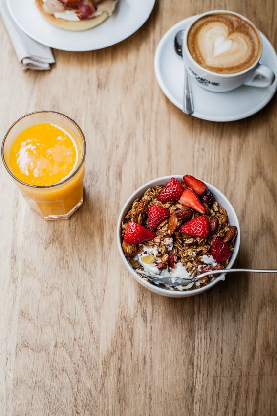 breakfast with granola, juice and coffee. mmmm. put in some bacon and buttered toast and id be set!
