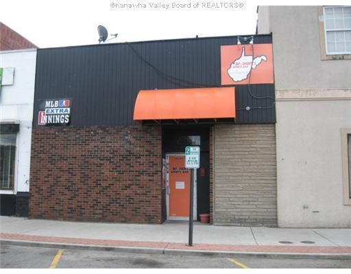 Listing details, photos, and maps for property for sale at 318 7TH AVENUE South Charleston, WV 25303.  318 7th Avenue - Currently leased as a sports bar.  Building has leased lottery machines, dart boards, juke box and pool table. Bring an offer! $165,000 - Traci Thomas Wells at RE/MAX Real Estate Unlimited can you help you find homes for sale in Kanawha Valley,  WV Area.