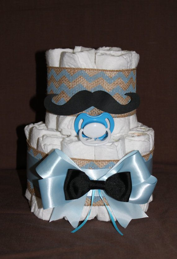 Mustache diaper cake is MADE to order and includes:  23 diapers (Pampers Swaddlers size 1 unless otherwise requested)  1 pacifier    Available