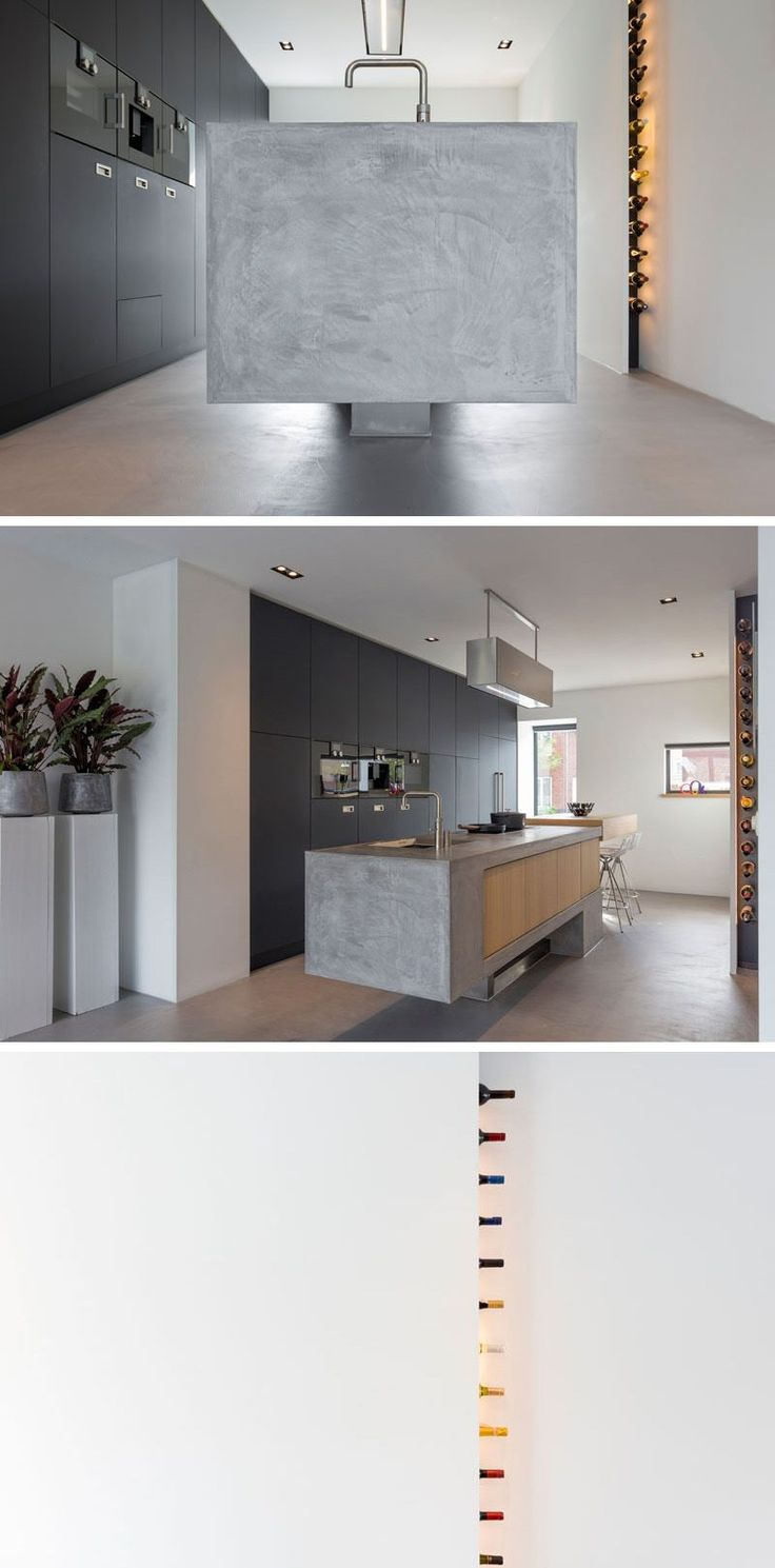 Wine storage is built-in behind a white wall in this modern kitchen.