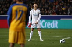 Cristiano Ronaldo Photos - Real Madrid's Portuguese forward Cristiano Ronaldo stands before a free kick during the UEFA Champions League Group H match between Apoel FC and Real Madrid on November 21, 2017, in the Cypriot capital Nicosia's GSP Stadium. / AFP PHOTO / Thomas COEX - APOEL Nikosia v Real Madrid - UEFA Champions League