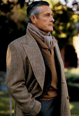 Men's Irish Tweed trench layered over a dark check blazer, cashmere sweater, muffler & dark trousers. Admire the gray highlights in his hair also.