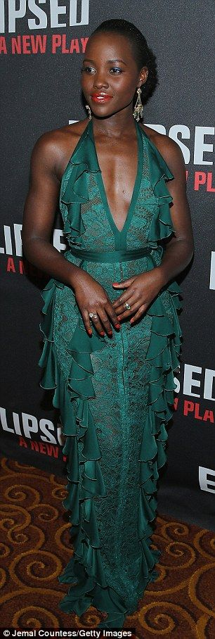 Taking the plunge!Stylist Micaela Erlanger dressed Lupita in an emerald lace, ruffled hal...