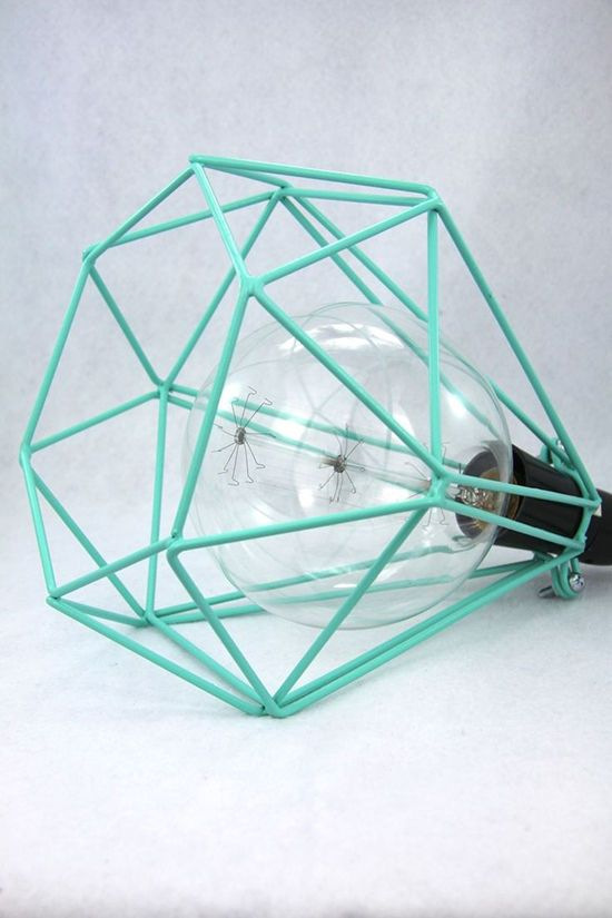 teal cage light. Fantastic! And cages are huge right now so it's a great way to incorporate some colour.