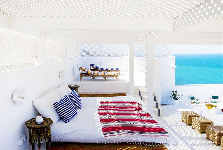 This Coastal Moroccan Home Is the Getaway Of Your DreamsOutdoor Beds, Beach House, Dreams Vacations, White Beds, Moroccan House, Vacations House, Sea View, Summer Night, Outdoor Spaces