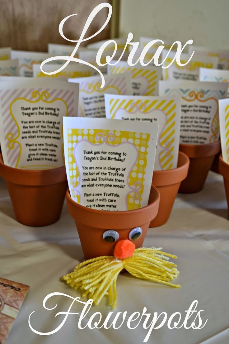 A Lorax Birthday Craft Idea - Lorax Flowerpots. To go along with the theme of the environment and keeping the trees happy, have kids make their own Lorax Flowerpots and then plant special Sunflowers in the decorated pots. All you need is orange pots, googly eyes, orange pom-poms, yarn, seeds, dirt and glue.