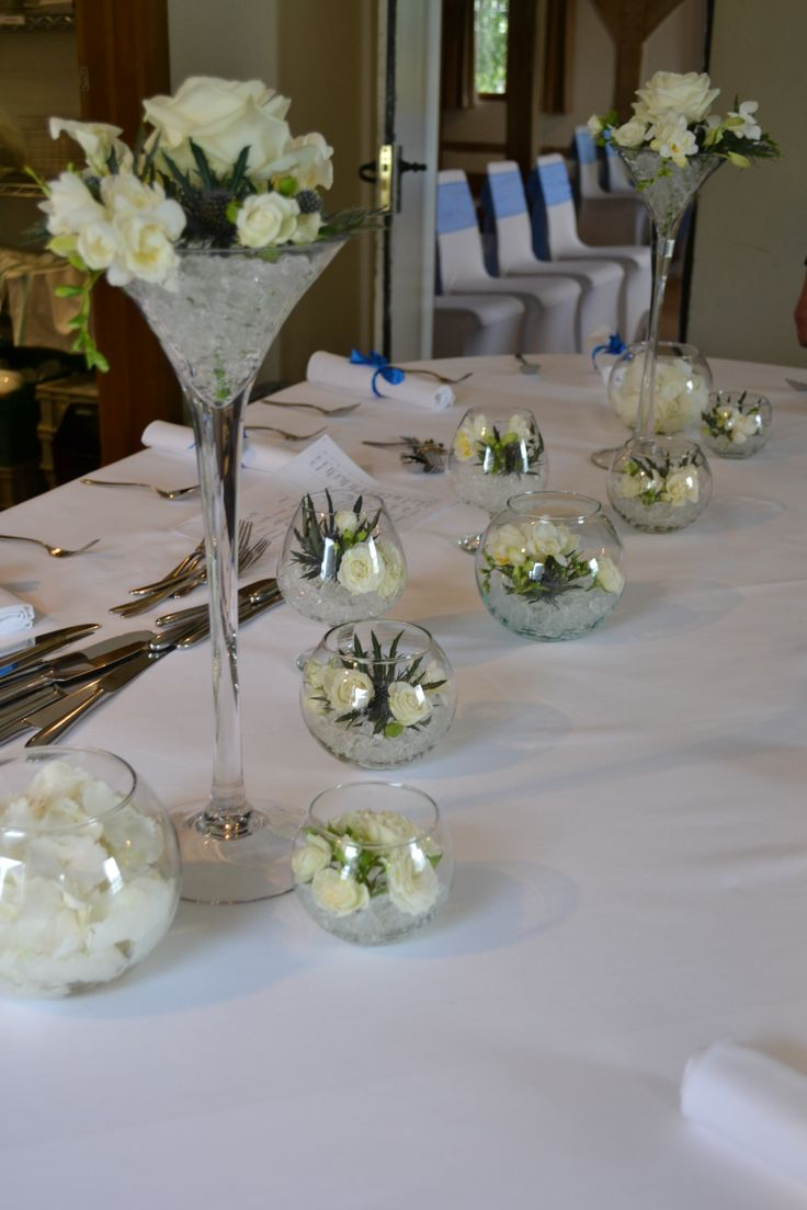 Tall Martini Vases Of White Roses, White Calla Lily, White Freesia And Blue  Eryngium