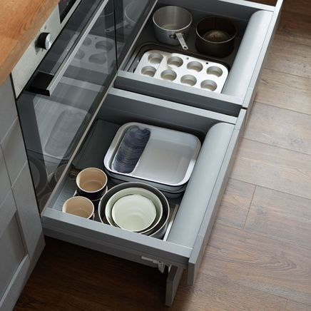 Built-under oven housing storage drawer