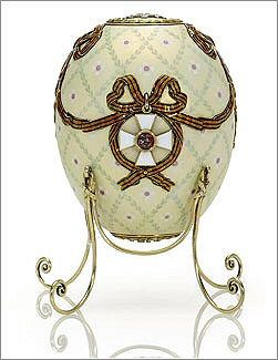 The 1916 Cross of St. George Egg. This was presented to Empress Marie Feodorovna, and was one of her few treasures that she was able to take away with her when she went into exile to Denmark in 1918. The egg is decorated with ribbands of the Order of St. George, an award given for military gallantry. The crosses on either side lift to reveal the surprise, portraits of Tsar Nicholas II and his son, Tsarevich Alexei. At the top is the empress' monogram in diamonds and the date at the other…