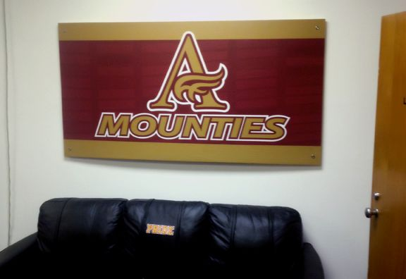 Mount Allison University Athletics and Recreation centre football lounge. MOUNTIES sign.  Design and installation: Gino Caron