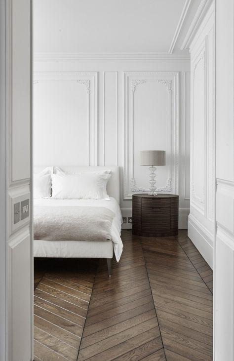 Light bedroom with lovely dark hardwood floors
