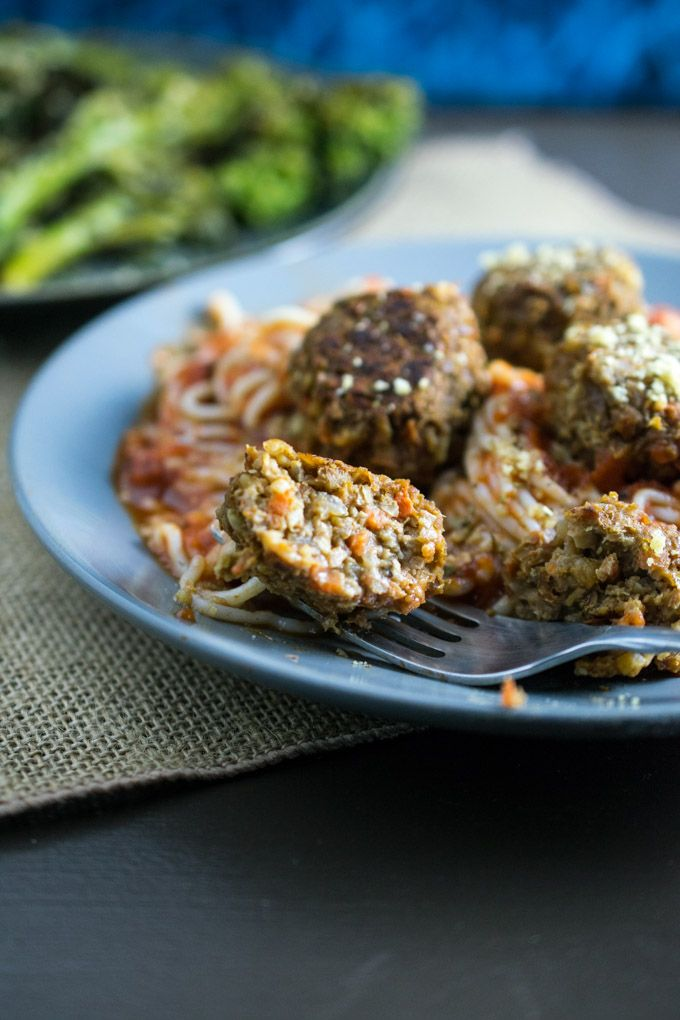 Spaghetti and tomato sauce, piled high with hearty and nutritious baked lentil balls. Vegetarian, gluten-free recipe thanks to tofu shirataki noodles.