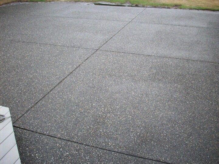 Decorative patio black exposed aggregate finish patios for Exposed concrete floor