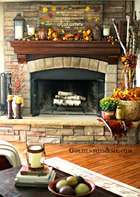 What a cozy fireplace - Hand painted and stenciled pallet sign on corner stone fireplace with birch logs, part of Fall Home Tour via www.goldenboysandme.com