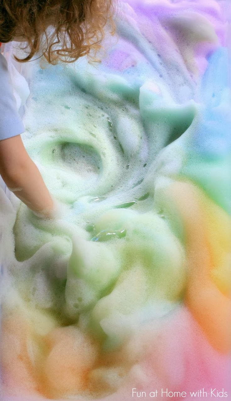 Rainbow Soap Foam Bubbles Sensory Play from Fun at Home with Kids - I love her idea of using liquid water colors instead of food coloring