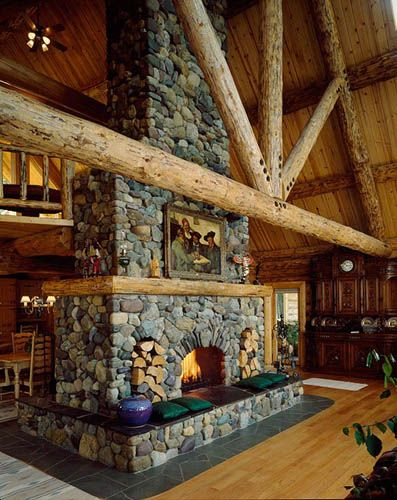 Montana Log Homes - beams and fireplace