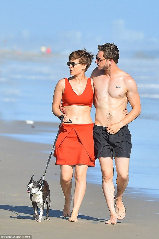 Casual: Both went shoeless for the stroll, with shirtless Bell displaying his muscled chest in a pair of shorts