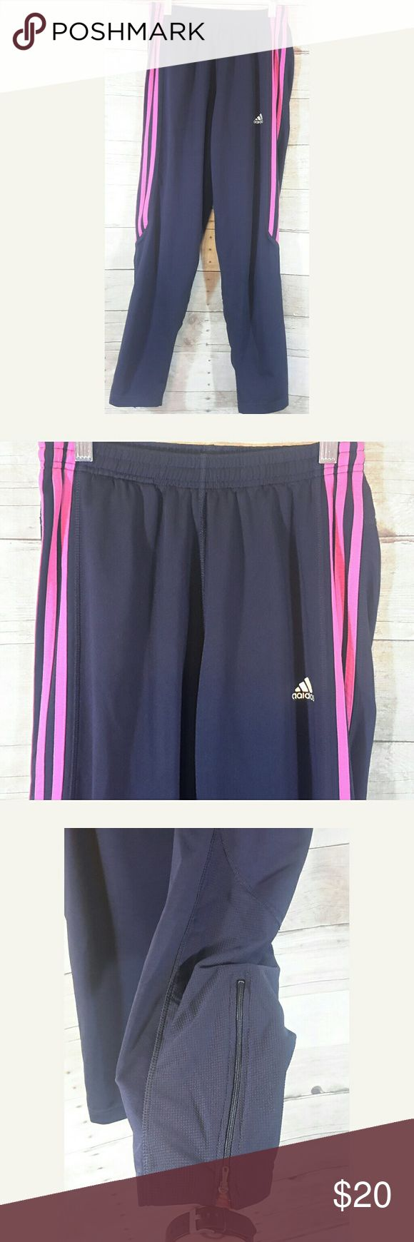 Adidas Climalite Running Pants Adidas Climalite Running Pants / Leggings  Dark blue with pink stripes Size medium  Zippers at the bottom of the legs 90% polyester,  10% spandex   Worn twice at most  Measurements  Inseam 27 Waist laid flat and unstretched 11.25 Rise 8.75  Any questions, please ask adidas Pants Track Pants & Joggers