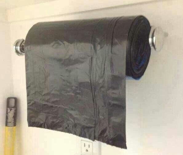 Pretty smart. Use paper towel roll for garbage bag dispenser! Put in a mud room, laundry room, or garage.