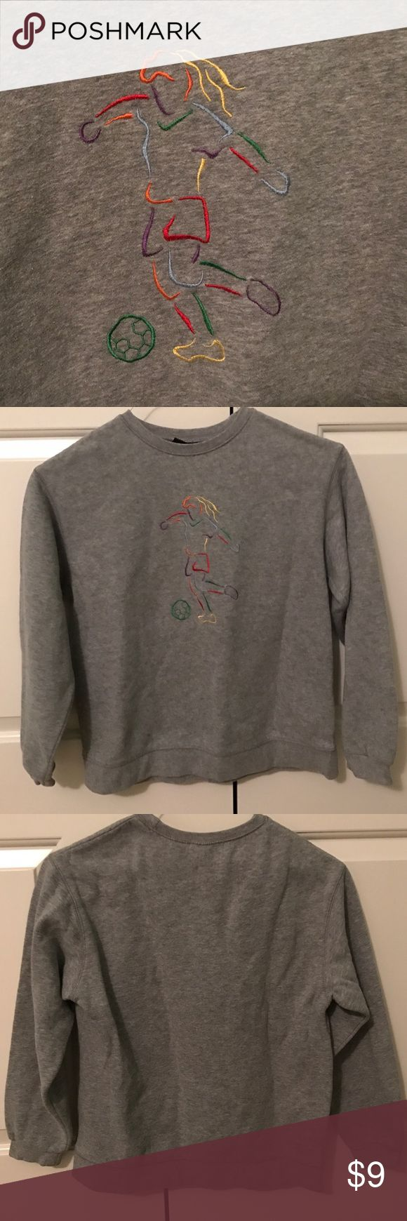 Girl's Soccer Sweatshirt Gray hoodie from Joe Boxer. No hood. Comfortable and fits well. Colorful image of a girl playing soccer on the front. Some sharpie near tags but otherwise in new condition (picture 4). Joe Boxer Shirts & Tops Sweatshirts & Hoodies