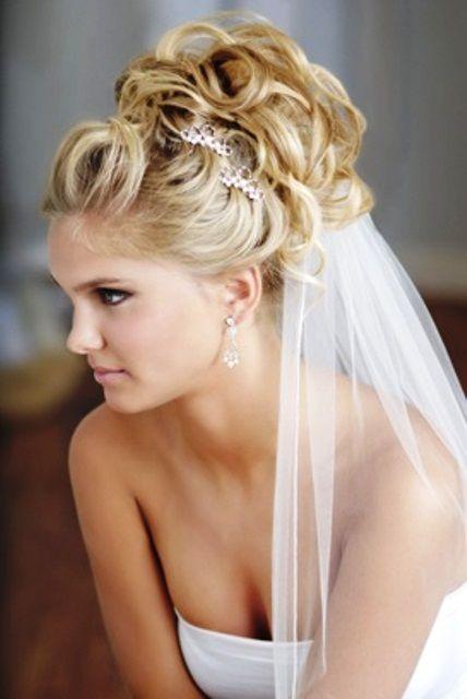 Bride's loose curls looped in updo bun bridal hair ideas  Toni Kami Wedding Hairstyles ♥ ❶ under veil