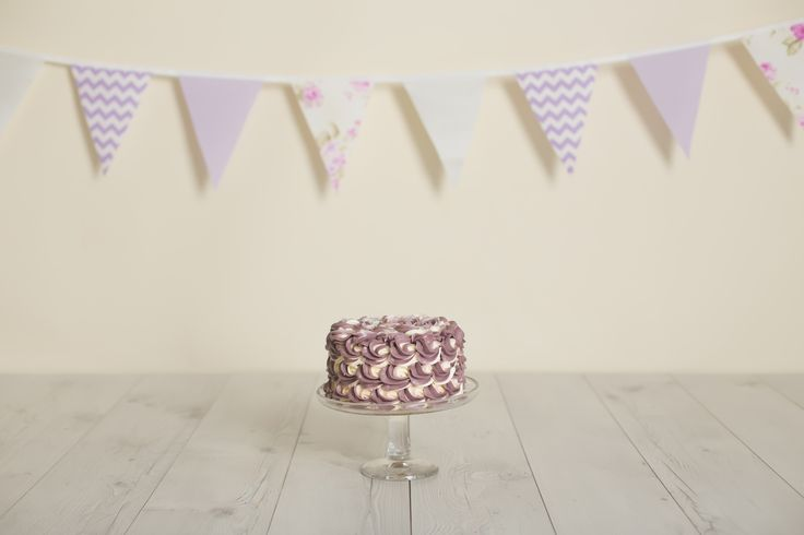 Lilac Purple Cake Smash Photo Setup. Bunting by Ivy Inspired from $6.00 a metre.  Photo Credit: Lullaby Grace Photography, Queenstown New Zealand