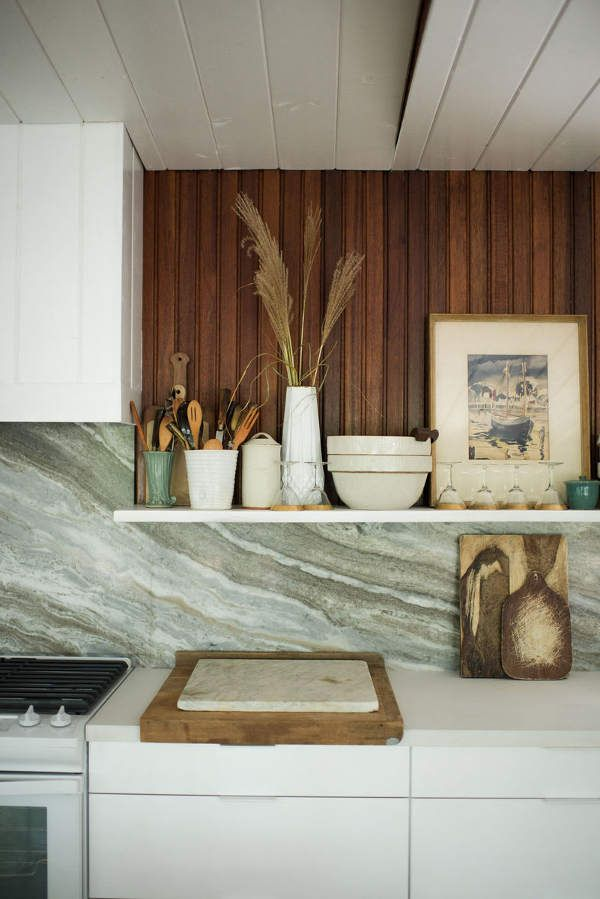 I love this limited palette of whites and creams married with the deep warmth of the stained wo...