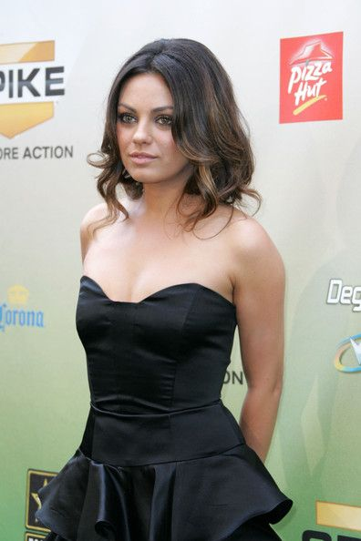 Mila Kunis: I know her hair is probably tucked under to make her hair shorter.. but I adore this!