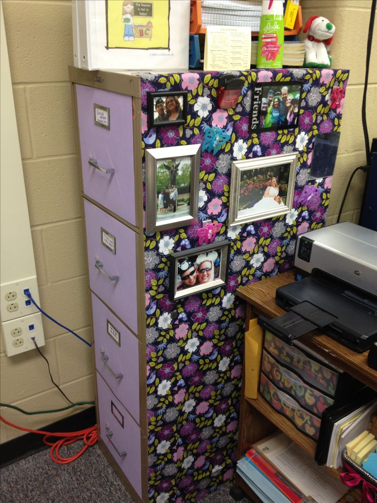 Decorated Filing Cabinet My upcycled filing cabinet in my classroom.  Used fabric and scrapbook paper in purple hues to bring beauty to a dull space. Dollar Store frames with magnetics to hold favorite photos.