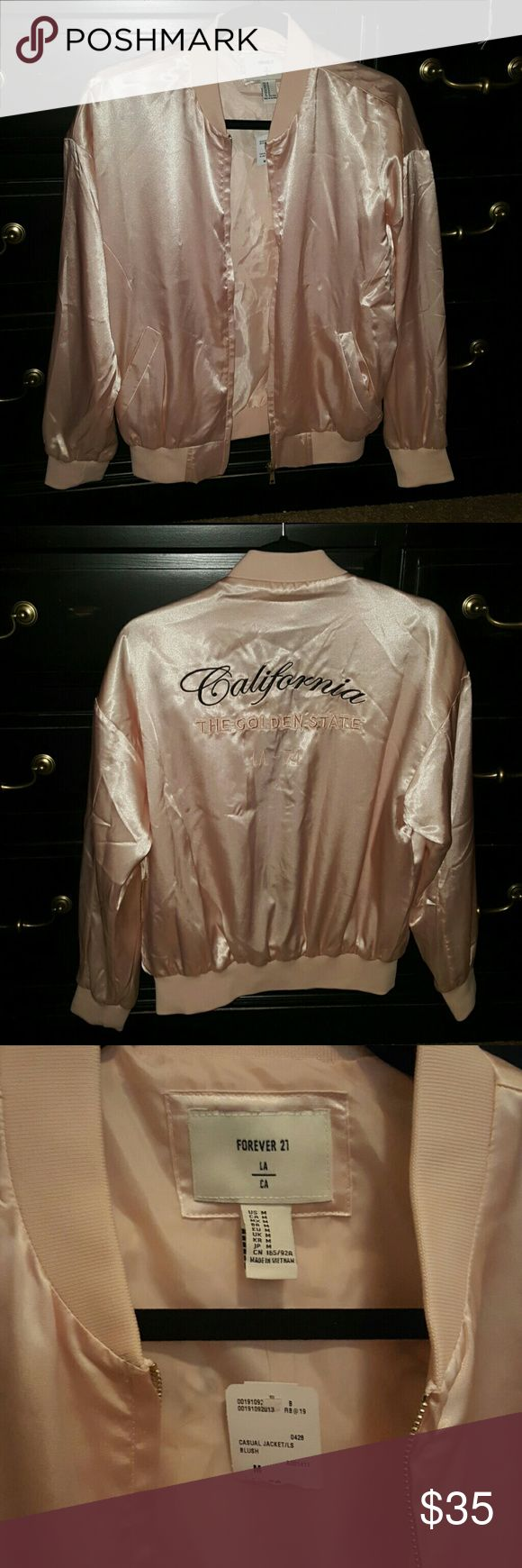 Forever 21 pink satin bomber jacket, California Forever 21 satin bomber jacket Soft baby pink color Broidered on the back California the golden state LA -74  Brand new with tags. Recieved as a gift for christmas but past the return date.  Size medium. Tags still attached Forever 21 Jackets & Coats