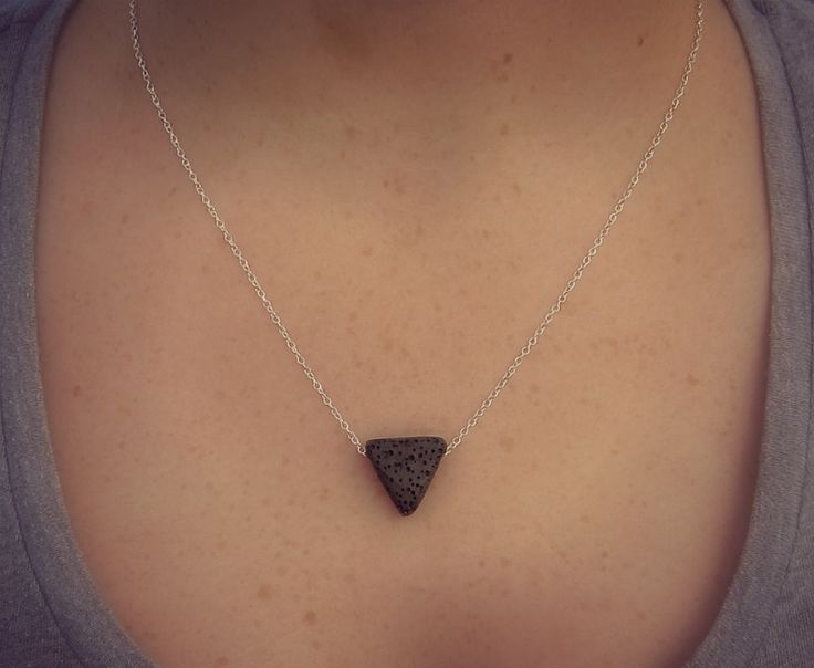 Minimalist lava triangle necklace.  Visit my Facebook page for more details.