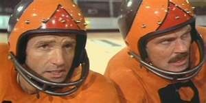 James Caan (Jonathan E.) and John Beck (Moonpie).