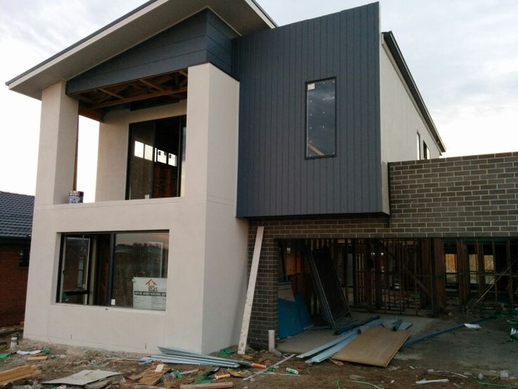 Surf Mist render colour and fascia. Dulux Signature cladding, Colorbond Monument and Austral Chiffon bricks