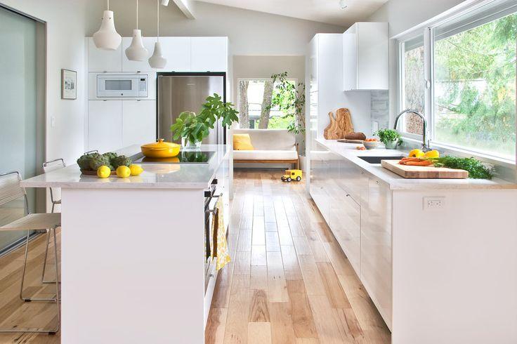 White modern kitchen with hickory floor.jpg