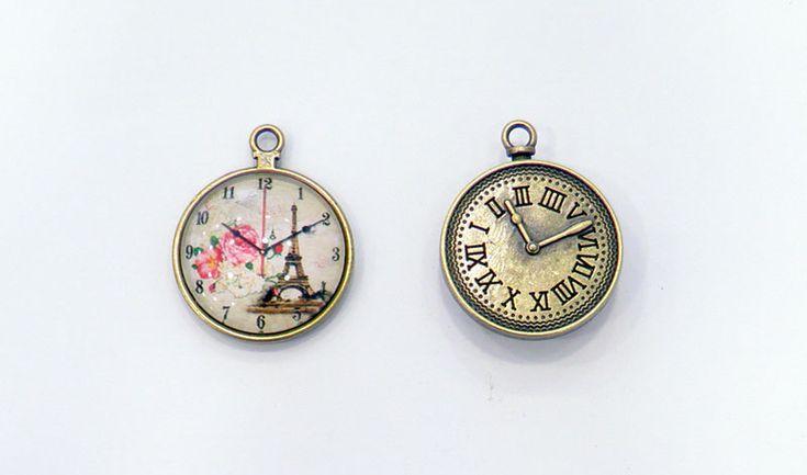 Γυάλινο ρολόι Πύργος του Άιφελ με μεταλλική κορνίζα.  ΔΙΑΣΤΑΣΕΙΣ: 30mm  Η…