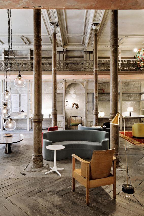 Reclaimed wooden floor, semi-circular sofa, nice light fixtures
