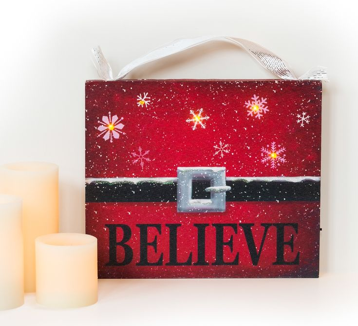 Festive image of Santa's belt on canvas is merry and bright. The snowflake LED lights add to it.  Only $17.99, see the entire illuminated holiday wall art collection.
