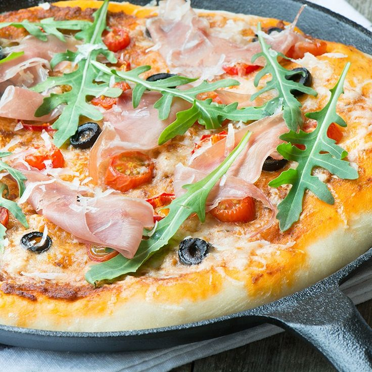 A delicious homemade pizza topped with sun dried tomato pesto, olives, chillies and Grana Padano cheese and then finished with rocket. (leave off the prosciutto)