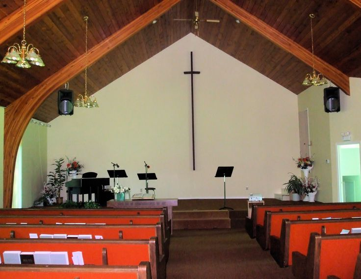 """Church Interior 1:  interior of a small-town Church of God.  Pews with Bibles and hymnals, piano and music stands on the dias, and a single plain cross on the back wall.  Quarter Page size, 1650 x 1275px (300ppi); prints at 5.5 x  4.25""""."""