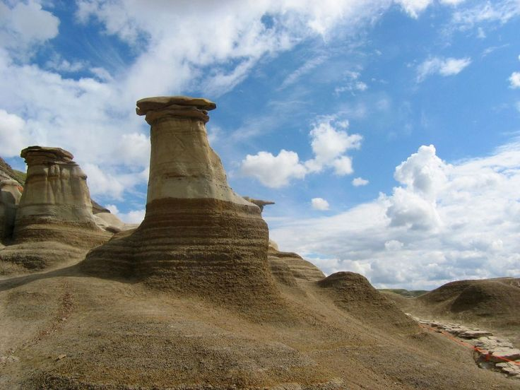 Things You Must See In Alberta This Summer - The Hoodoos near Drumheller  Where: Four hours from Edmonton, 1.5 hours from Calgary.  What to do: Explore the incredible formations of the arid hoodoos (but please don't deface them.) These hoodoos in particular formed 70 - 75 million years ago during the Cretaceous Period and maintain a unique mushroom-like appearance. The underlying base erodes at a faster rate compared to the capstones, a rate of nearly one centimeter per year, faster than…