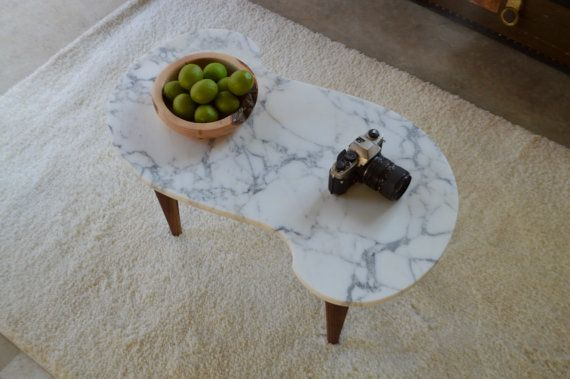 S-shaped marble coffee table with walnut legs