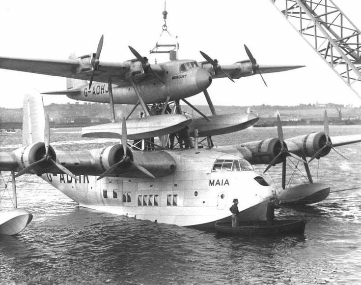 """aber-flyingtiger: """" flytofight: """" A flying boat on top of another flying boat. """" This is the Short Mayo composite, designed to allow Westbound Transatlantic mail flights from the United Kingdom. The seaplane, named Mercury, would detach from the..."""