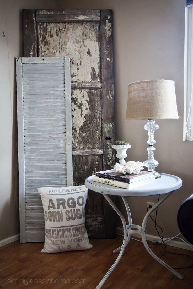 vintage corner display - old door, shutter - keep thinking I want to do this in the corner of my living room