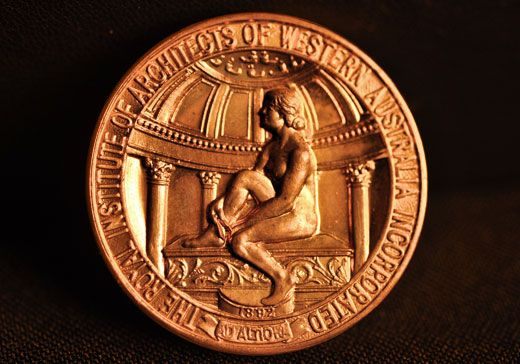 Commissioned from The Perth Mint in 1932 by the Royal Australian Institute of Architects WA, this gorgeous 37mm bronze medal is notable for the remarkable depth of its design.