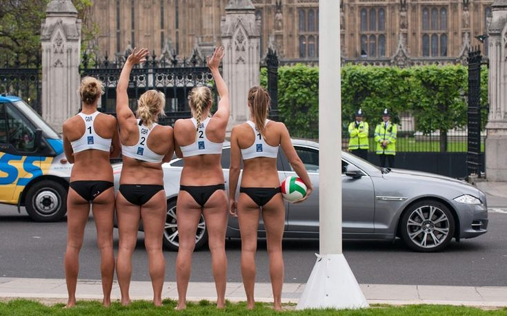 Members of the Great Britain Beach Volleyball team (left to right) Denise Johns, Lucy Bolton, Shauna Mullin and Zara Dampney wave at motorists in Parliament Square to launch Transport for London's Temporary Road Changes planning tool    Picture: Dominic Lipinski/PA